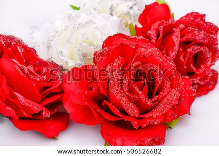 Red and white fabric roses closeup picture.