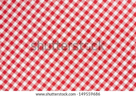 Red and white gingham tablecloth diagonal texture background  - stock photo