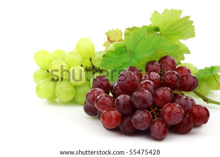 red and white grapes and some foliage  on a white background