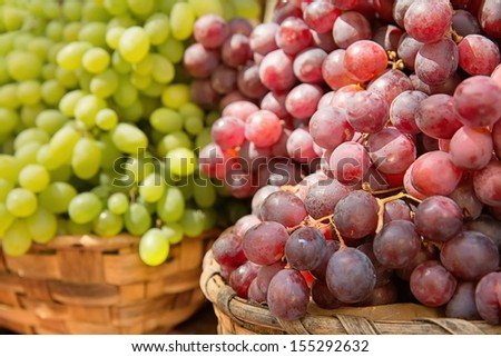 Red and white grapes of different varieties - stock photo
