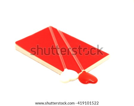 Red and white heart on the open red book isolated on white background, select focus.  - stock photo