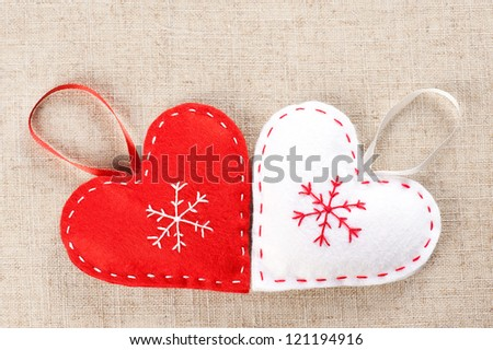 Red and white hearts handmade of felt - stock photo