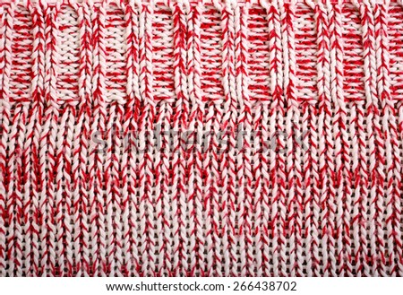 Red and white knitted wool texture pattern - stock photo