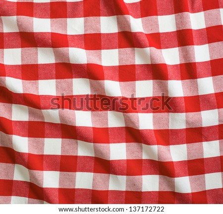 red and white linen tablecloth - stock photo