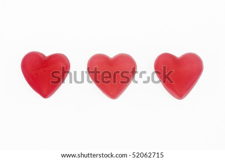 red and white love heart sweets on a white background - stock photo