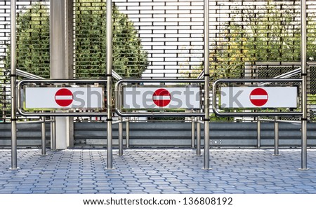 """Red and white """"No Entry"""" Signs at a closed Entrance - stock photo"""