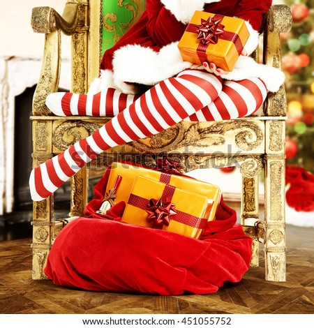 red and white pantyhose and xmas box and woman legs  - stock photo