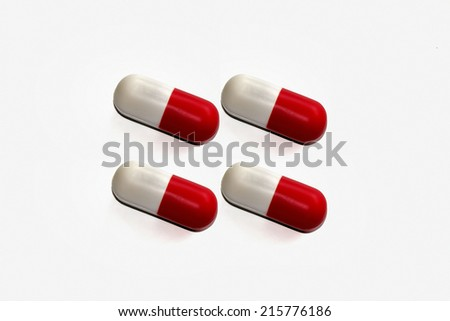 Red and white pill