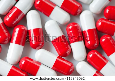 Red and white pills, view from above - stock photo