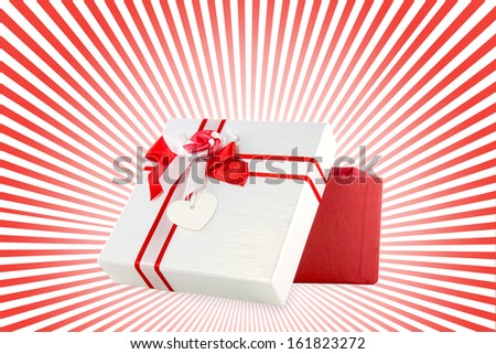 red and white present wrap by ribbon on red and white background - stock photo