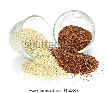 Red and white quinoa grain in glass bowls on white background - stock photo