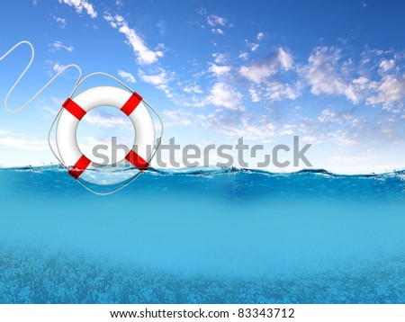 Red and white rescue ring floating on blue waves - stock photo