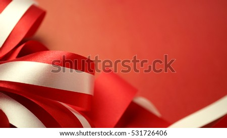 red and white ribbons in blurred style on craft paper for christmas and new year background