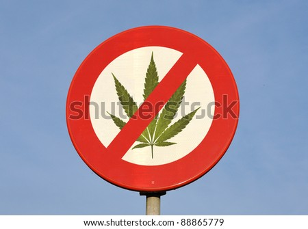 Red and white round reflective prohibition sign with Cannabis leaf - stock photo