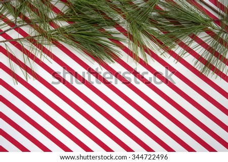 Red and white striped Christmas background with pine and room for copy space