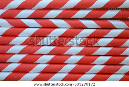 Red and White striped party straws pattern close up