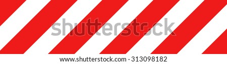 Red and white striped road warning post - stock photo