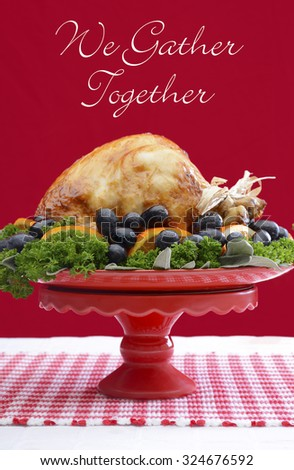 Red and white theme Thanksgiving Table setting with Roast Turkey Chicken on large platter centerpiece.  - stock photo