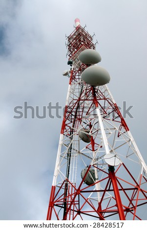 Red and white tower of communications with their antennas in a misty morning - stock photo