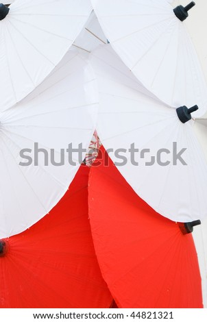 Red and white traditional umbrellas at a handicraft festival in Bo Sang, Chiang Mai, Thailand. - stock photo