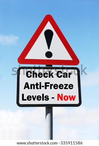 Red and white triangular road sign with a Check Car Anti-Freeze Levels Now concept against a partly cloudy sky background