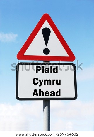 Red and white triangular road sign with a Plaid Cymru Party ahead concept against a partly cloudy sky background - stock photo