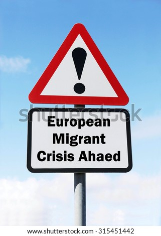 Red and white triangular road sign with a warning of a European Migrant Crisis Ahead concept against a partly cloudy sky background