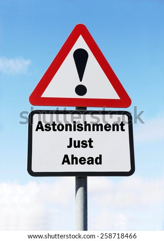 Red and white triangular road sign with a warning of Astonishment ahead concept against a partly cloudy sky background