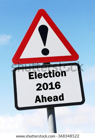 Red and white triangular road sign with an Election 2016 Ahead concept against a partly cloudy sky background - stock photo