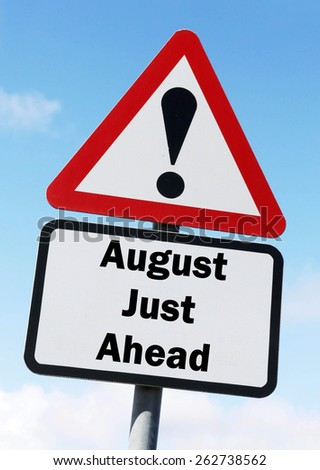 Red and white triangular warning road sign informing that August is Just Ahead concept against a partly cloudy sky background - stock photo