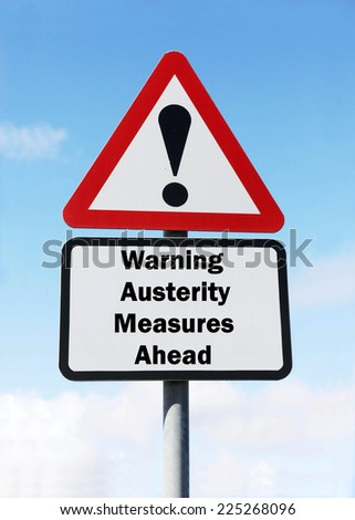 Red and white triangular warning road sign with a warning of Austerity Measures ahead concept against a partly cloudy sky background