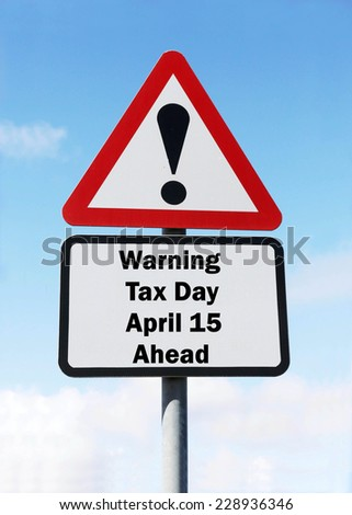 Red and white triangular warning road sign with a warning of tax day on April 15 ahead concept against a partly cloudy sky background - stock photo