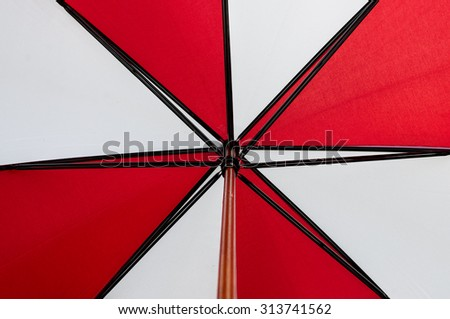 Red and White umbrella background - stock photo