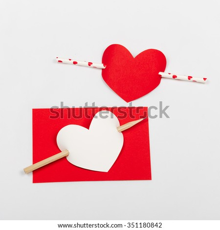 Red and white valentines greetings card heart shape with arrow