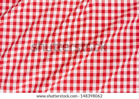 Red and white wavy tablecloth texture background  - stock photo