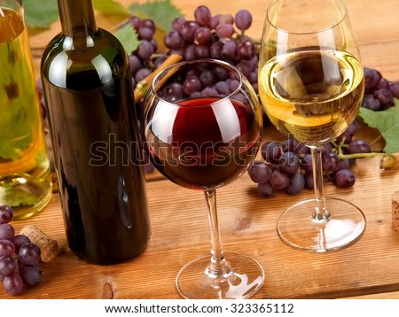 Red and white wine and grapes, close up - stock photo