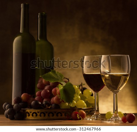 Red and white wine glasses and grape
