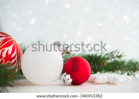 Red and white xmas ornaments and xmas tree on glitter holiday background. Merry christmas card. Winter holidays. Xmas theme. Happy New Year. - stock photo