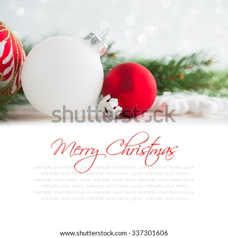 Red and white xmas ornaments and xmas tree on white background. Merry christmas card. Winter holidays. Xmas theme. Happy New Year. Space for text. - stock photo