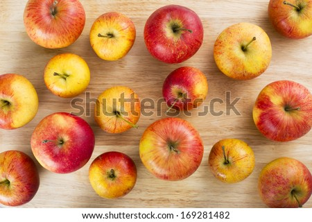 Red and yellow apples on table viewed from above. - stock photo