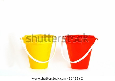 red and yellow beach toy buckets - stock photo