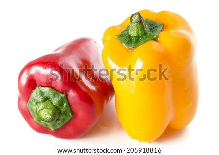 Red and Yellow Bell pepper on white background - stock photo