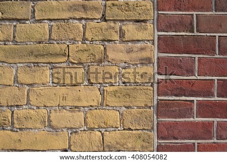 Red and yellow brick wall background - stock photo
