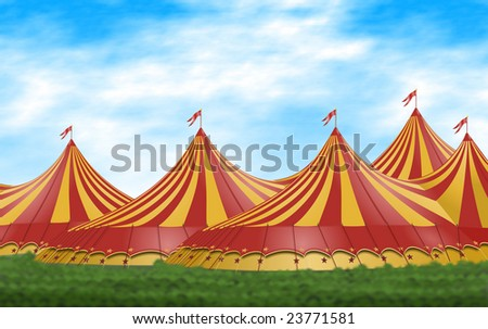Red and yellow circus tents placed on a green field - stock photo