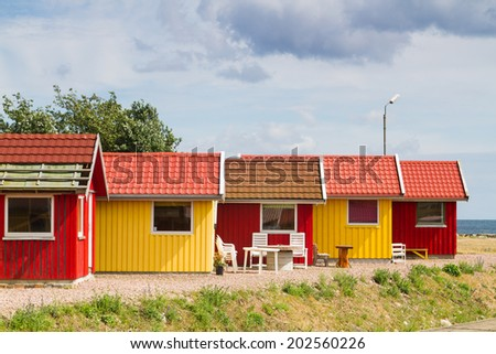 Red and yellow coastal wooden houses on Bornholm, Denmark - stock photo