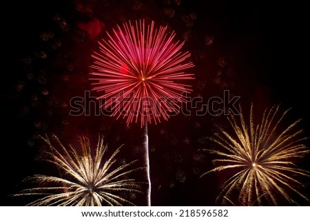 Red and yellow fireworks in dark sky background, Malta fireworks festival, 4 July, Independence day,explode,fireworks isolated in dark background close up with the place for text, fireworks festival - stock photo