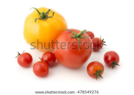 Red and yellow fresh tomatoes on white background