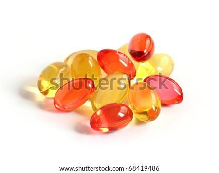 red and yellow gel capsules isolated on white background - stock photo