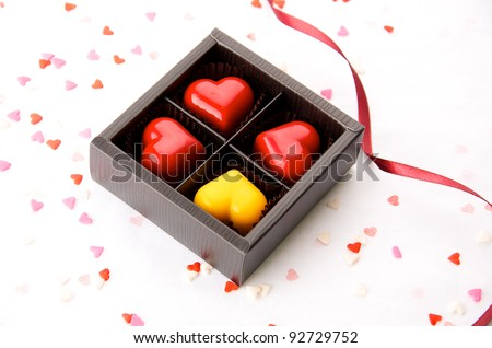 red and yellow hearts chocolate in the box - stock photo