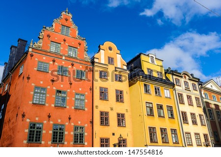 Red and Yellow iconic buildings on Stortorget,  a small public square in Gamla Stan, the old town in central Stockholm, Sweden. - stock photo